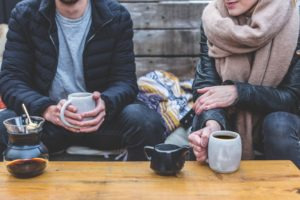 Dating couple having coffee and talking